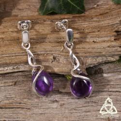 Boucles d'oreilles elfiques en argent ornées d'une Améthyste violette entourée de spirales féeriques.