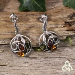 Boucles d'oreilles féeriques et Art Nouveau ornée d'un Trio de gouttes d'Ambre et de volutes en Argent massif.